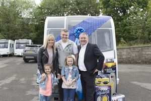 Winners the Jacksons: Emma, Stephen, Jasmine and Bella receive their new Bailey Ancona caravan from Truma UK's MD, Martin Fitzpatrick